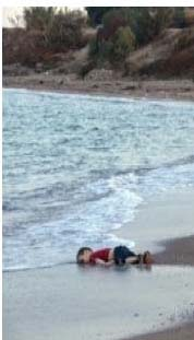picture printed by media of little Kurdish boy on beach