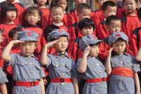 Chinese Communist Children saluting